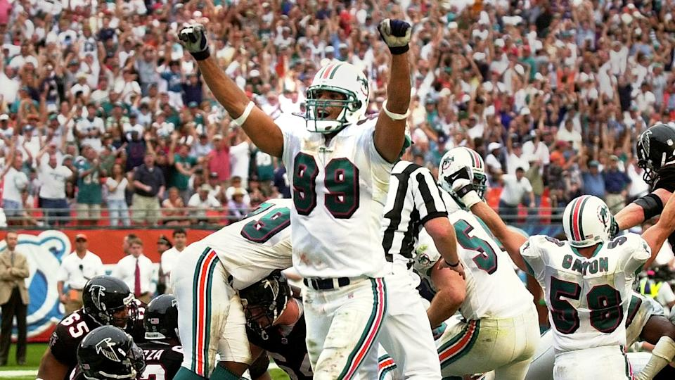Mandatory Credit: Photo by Tony Gutierrez/AP/Shutterstock (6456382a)TAYLOR Miami Dolphins' Jason Taylor (99) celebrates his teams goal line stand against the Atlanta Falcons that sealed the 21-14 Dolphins win, at Pro Player Stadium in MIamiFALCONS DOLPHINS, MIAMI, USA.