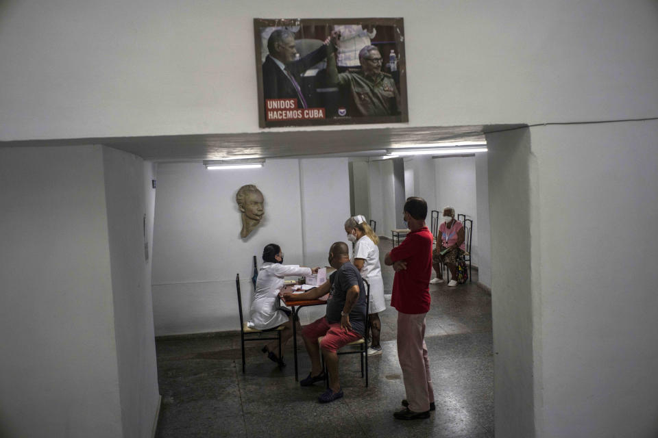 Nurses attend people who will be given a shot of the Cuban Abdala vaccine for COVID-19 at a cultural center being used as a vaccination center during the new coronavirus pandemic in Havana, Cuba, Monday, Aug. 2, 2021. (AP Photo/Ramon Espinosa)