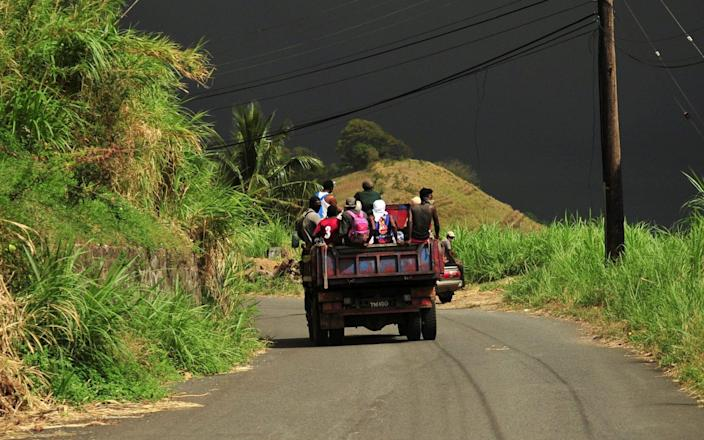 Evacuees travel on a farmer's truck as they leave the village of Rose Hall following the eruption of La Soufriere volcano on the eastern Caribbean island of St Vincent - REUTERS/Robertson S. Henry