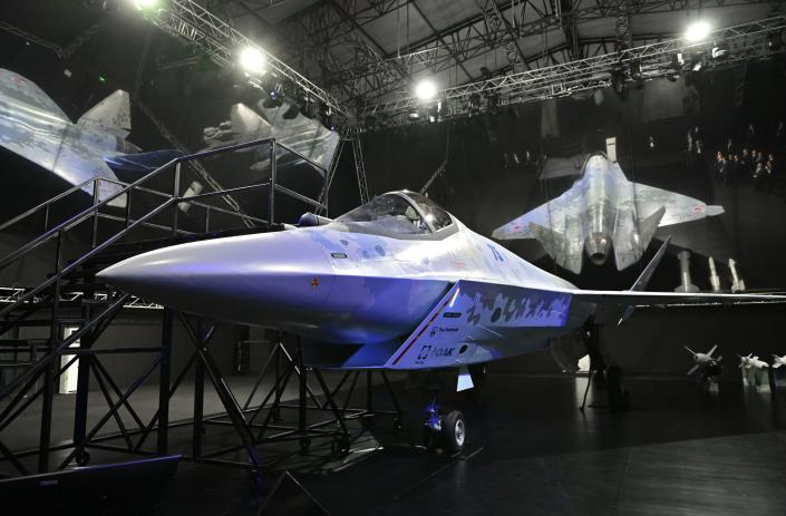 A prototype of a new fighter jet that features stealth capabilities and other advanced characteristics is exhibited at the MAKS-2021 International Aviation and Space Salon in Zhukovsky outside Moscow, Russia, Tuesday, July 20, 2021. Russia on Tuesday unveiled a prototype of its prospective new fighter jet at the Moscow air show. (Alexei Nikolsky, Sputnik, Kremlin Pool Photo via AP)