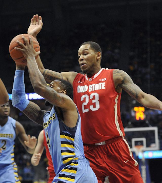 Marquette's 's Todd Mayo, left, drives to the basket as Ohio State's' Amir Williams (23) defends during the first half of an NCAA college basketball game, Saturday, Nov. 16, 2013, in Milwaukee. (AP Photo/Jim Prisching)