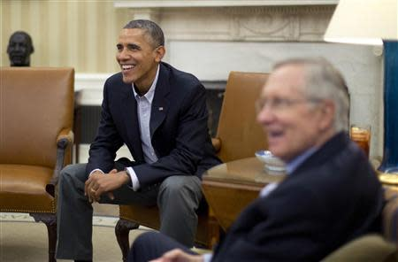 U.S. President Obama meets U.S. Senate Democrats including Senate Majority Leader Reid in the Oval Office of the White House in Washington
