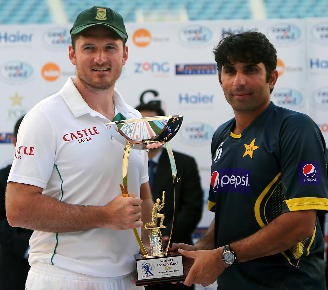Graeme Smith (L) of South Africa and Misbah Ul Haq of Pakistan pose with the trophy at end of their second Test cricket match in Dubai on October 26, 2013. Pakistan won the first test match while South Africa won the second. South Africa kept their seven-year unbeaten away record intact with an innings and 92-run win over Pakistan in the second and final Test in Dubai, squaring the two-match series 1-1. AFP PHOTO/MARWAN NAAMANI        (Photo credit should read MARWAN NAAMANI/AFP/Getty Images)