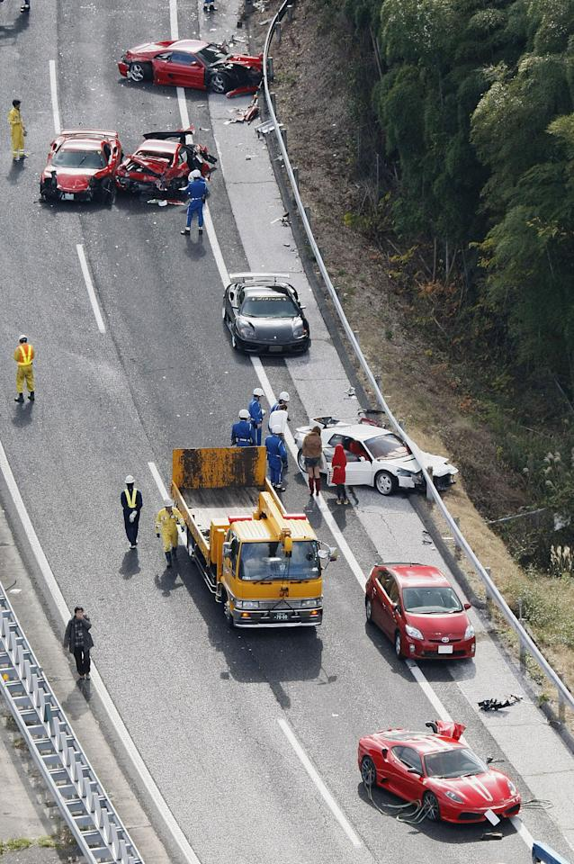 Damaged luxury cars are seen at the site of a traffic accident on the Chugoku Expressway in Shimonoseki, southwestern Japan, Sunday, Dec. 4, 2011. Thirteen sports cars, including eight Ferraris, a Lamborghini and two Mercedes-Benz, were involved in the accident, slightly injuring 10 people. (AP Photo/Kyodo News) JAPAN OUT, MANDATORY CREDIT, NO LICENSING IN CHINA, FRANCE, HONG KONG, JAPAN AND SOUTH KOREA