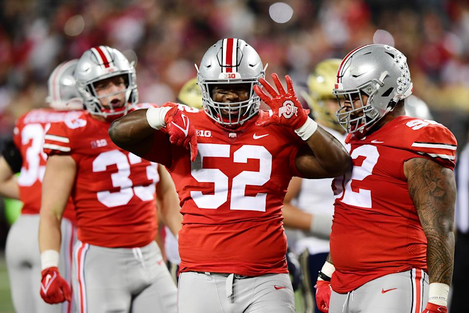 COLUMBUS, OHIO - SEPTEMBER 25: Antwuan Jackson #52 of the Ohio State Buckeyes celebrates after sacking DJ Irons #0 of the Akron Zips in the first half during their game at Ohio Stadium on September 25, 2021 in Columbus, Ohio. (Photo by Emilee Chinn/Getty Images)