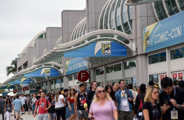 People walk in front of the Convention Center during Comic-Con San Diego in July 2019; 2020's edition will be online