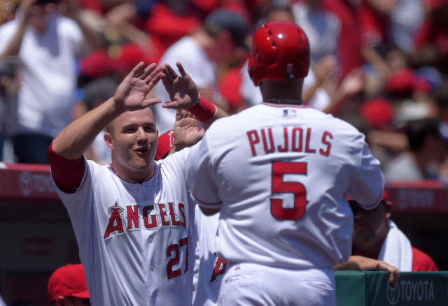 Los Angeles Angels' Albert Pujols, right, is congratulated by teammate Mike Trout after hitting a solo home run during the first inning of a baseball game against the Texas Rangers, Sunday, May 4, 2014, in Anaheim, Calif. (AP Photo/Mark J. Terrill)
