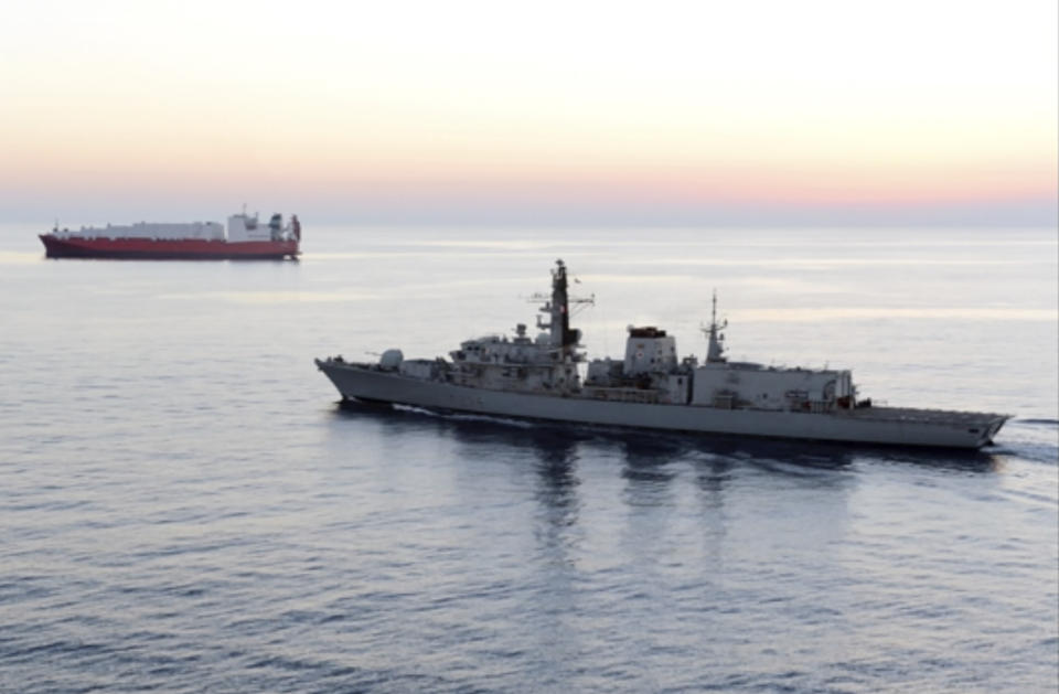 """In this image from file video provided by UK Ministry of Defence, British navy vessel HMS Montrose escorts another ship during a mission to remove chemical weapons from Syria at sea off coast of Cyprus in February 2014. The British Navy said it intercepted an attempt on Thursday, July 11, 2019, by three Iranian paramilitary vessels to impede the passage of a British commercial vessel just days after Iran's president warned of repercussions for the seizure of its own supertanker. A U.K. government statement said Iranian vessels only turned away after receiving """"verbal warnings"""" from the HMS Montrose accompanying the commercial ship through the narrow Strait of Hormuz. (UK Ministry of Defence via AP)"""