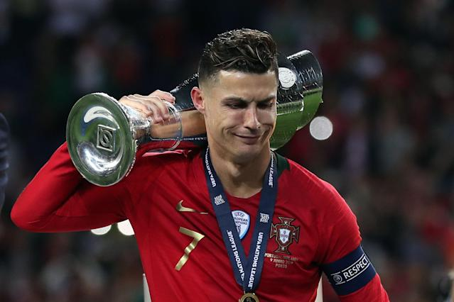"Portugal's <a class=""link rapid-noclick-resp"" href=""/soccer/players/373159/"" data-ylk=""slk:Cristiano Ronaldo"">Cristiano Ronaldo</a> holds the trophy after winning the UEFA Nations League Final football match between Portugal and Netherlands. (Getty)"
