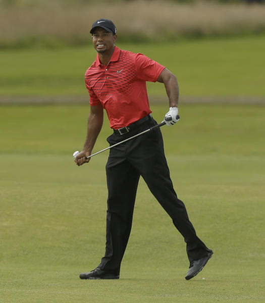 Tiger Woods of the United States watches his shot on the third fairway at Royal Lytham & St Annes golf club during the final round of the British Open Golf Championship, Lytham St Annes, England Sunday, July 22, 2012. (AP Photo/Jon Super)