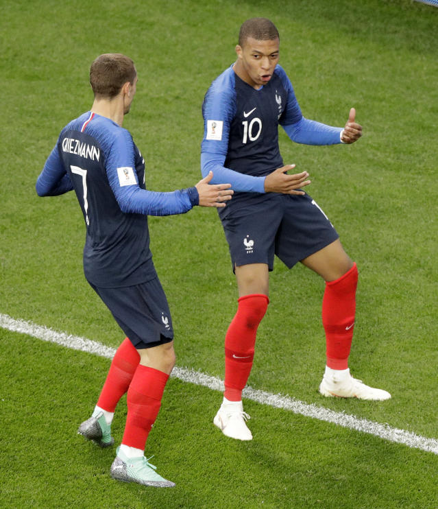 France's Kylian Mbappe celebrates after scoring the opening goal with teammate France's Antoine Griezmann, left, during the group C match between France and Peru at the 2018 soccer World Cup in the Yekaterinburg Arena in Yekaterinburg, Russia, Thursday, June 21, 2018. (AP Photo/Mark Baker)