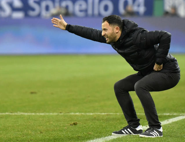 FILE - In this Dec. 19, 2017 file photo Schalke's head coach Domenico Tedesco reacts during the German soccer cup match between FC Schalke 04 and FC Cologne in Gelsenkirchen, Germany. With eight games of the season remaining, Tedescos side is best-placed for a return to the Champions League along with soon-to-be-crowned champion Bayern Munich. (AP Photo/Martin Meissner, file)