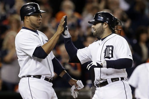 Detroit Tigers' Alex Avila, right, is congratulated by Jhonny Peralta after hitting a two-run home run against the Kansas City Royals in the fourth inning of a baseball game in Detroit, Wednesday, Sept. 26, 2012. (AP Photo/Paul Sancya)