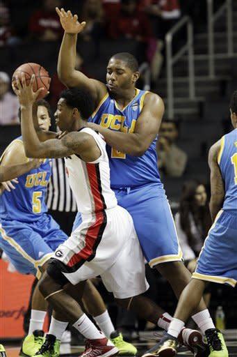 UCLA center Joshua Smith (2) defends Georgia guard Charles Mann during the first half of their NCAA college basketball game for third place at the Legends Classic at Barclays Center, Tuesday, Nov. 20, 2012, in New York. (AP Photo/Kathy Willens)