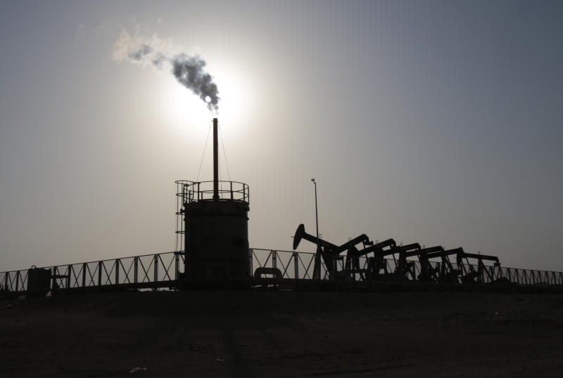 Oil pumps work at sunset Thursday, July 16, 2015, in the desert oil fields of Sakhir, Bahrain. Many analysts estimate that Iran has piled up tens of millions of barrels on floating barges that can be exported soon after sanctions have been lifted. So it's possible that once economic sanctions are lifted and Iran can sell more oil, crude oil prices could come down. (AP Photo/Hasan Jamali)