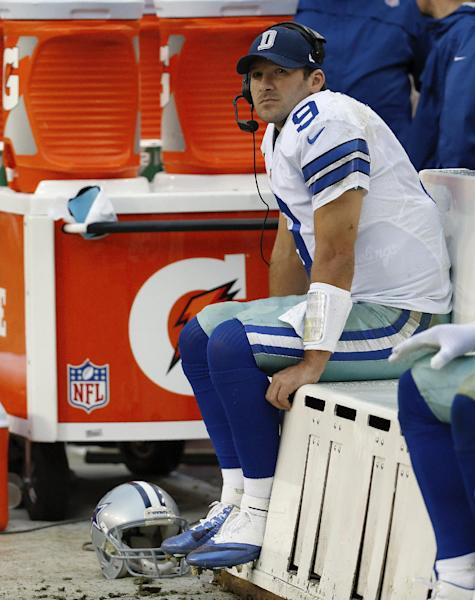 Dallas Cowboys quarterback Tony Romo seats on the beach as watches the action on the big screen television during the second half of an NFL football game against the Washington Redskins in Landover, Md., Sunday, Dec. 22, 2013. (AP Photo/Alex Brandon)