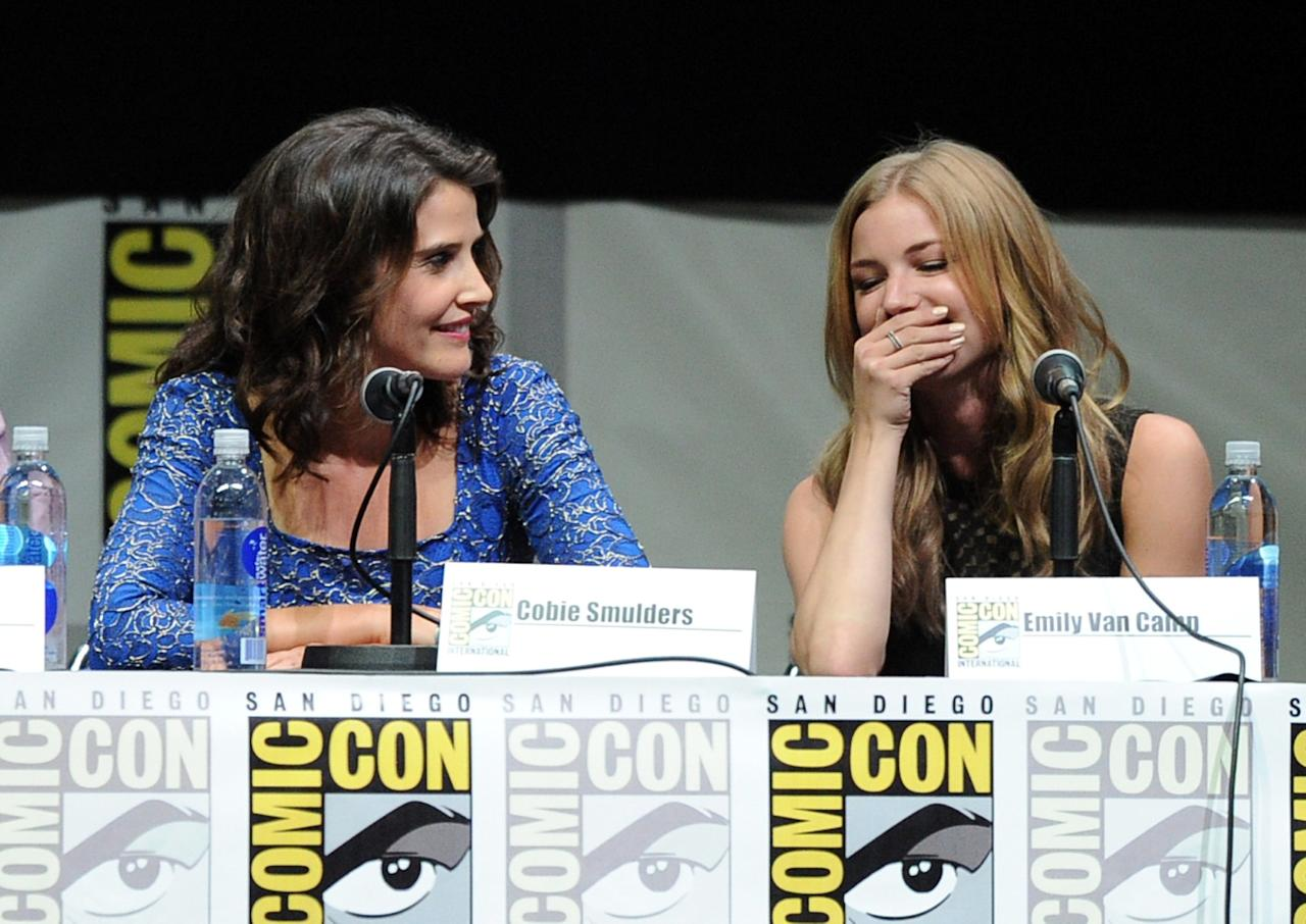 "SAN DIEGO, CA - JULY 20: Actresses Cobie Smulders (L) and Emily VanCamp speak onstage at Marvel Studios ""Thor: The Dark World"" and ""Captain America: The Winter Soldier"" during Comic-Con International 2013 at San Diego Convention Center on July 20, 2013 in San Diego, California. (Photo by Kevin Winter/Getty Images)"