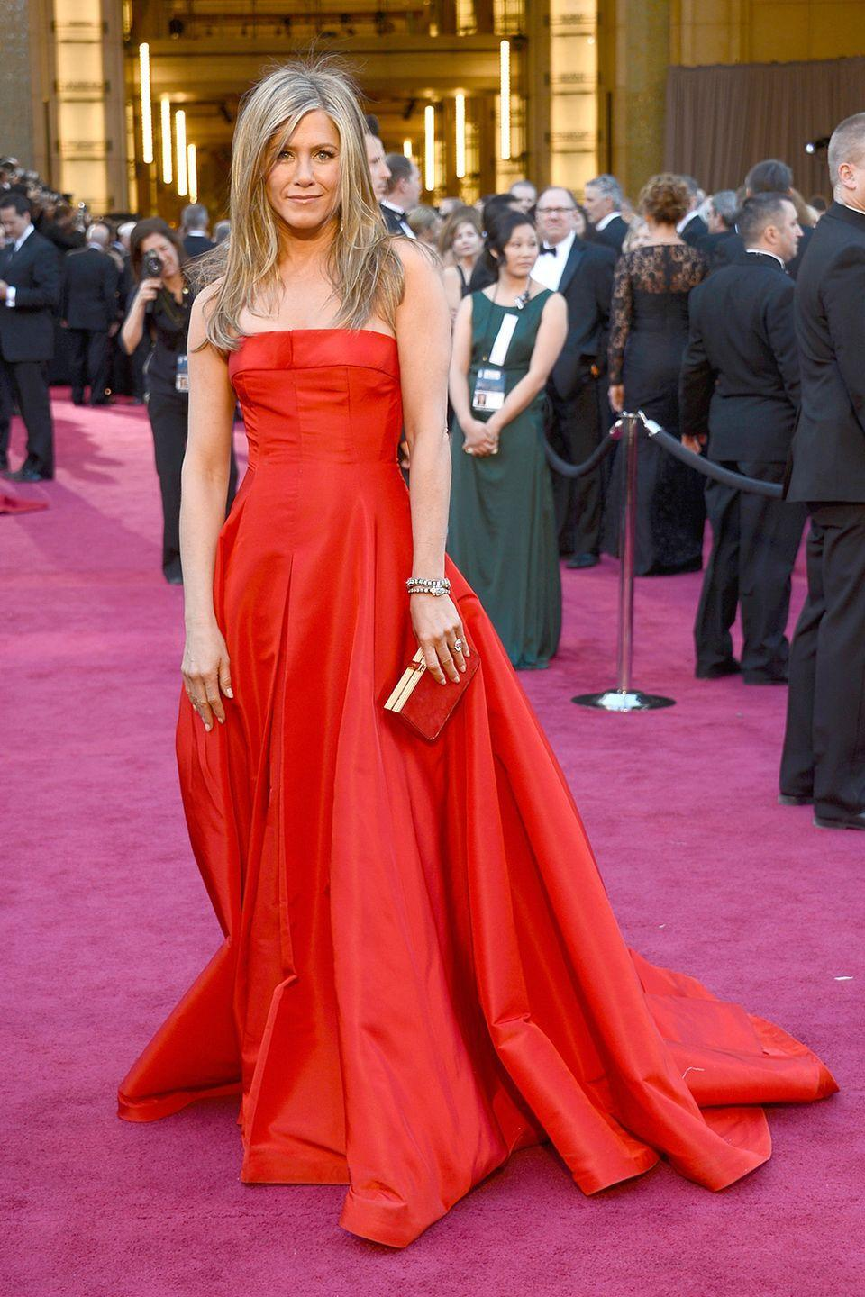 <p>While the attention is always on the nominees, it was hard not to notice presenter Jennifer Aniston in this crimson Valentino Haute Couture gown. </p>