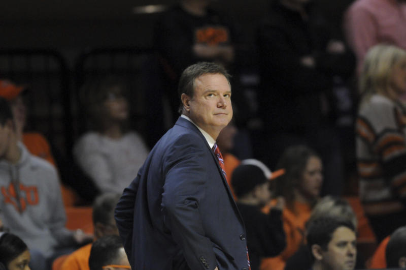Kansas head coach Bill Self looks to the scoreboard during an NCAA college basketball game in Stillwater, Okla., Saturday, March 3, 2019. (AP Photo/Brody Schmidt)