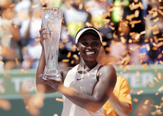 Sloane Stephens holds her trophy after defeating Jelena Ostapenko, of Latvia, in the final of the Miami Open tennis tournament, Saturday, March 31, 2018, in Key Biscayne, Fla. Stephens won 7-6 (5), 6-1. (AP Photo/Lynne Sladky)
