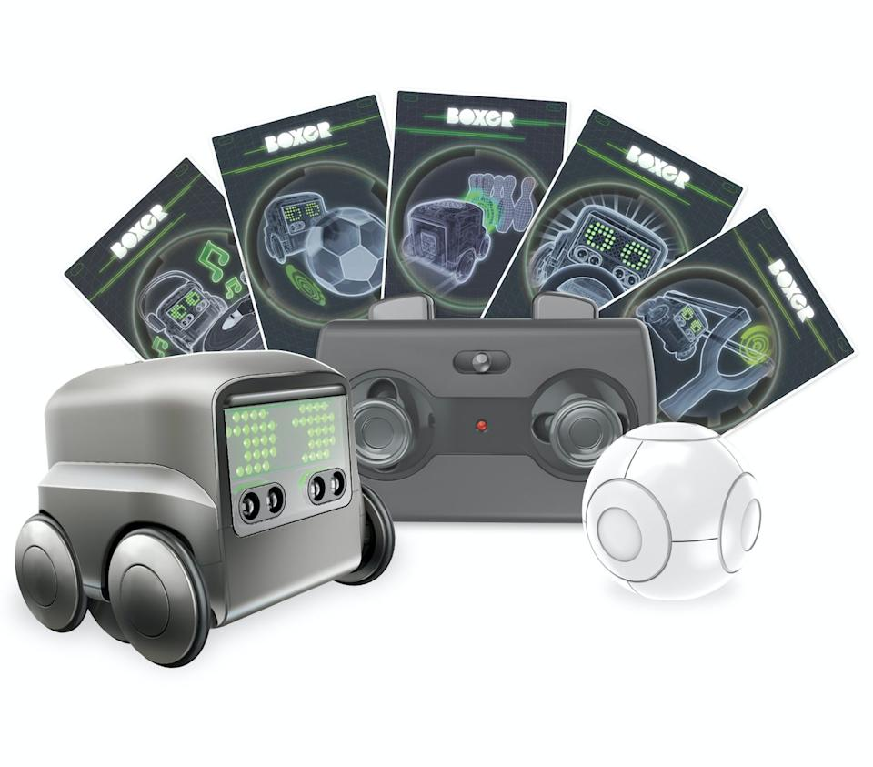 """This mini robot reacts to senses around him, so he'll follow your hands if you want him to move. You can also play loads of games with the robot - he just needs to roll over an activity card to scan it to know what to do.<br />Price: £80<br />Ages: 6+<br /><a href=""""http://hamleys.com/boxer-robot.ir"""" target=""""_blank"""" rel=""""noopener noreferrer"""">Click here to buy.</a>"""