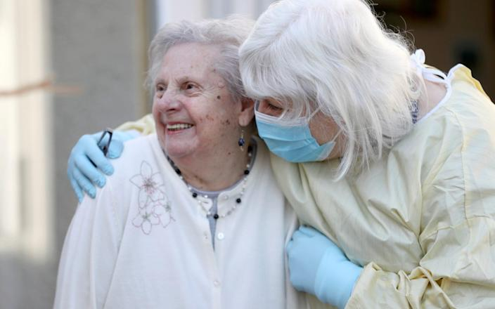 Fiona Scott visits her mother Mary Cook at a nursing home for the first time since the lockdown started in Scotland - Pool