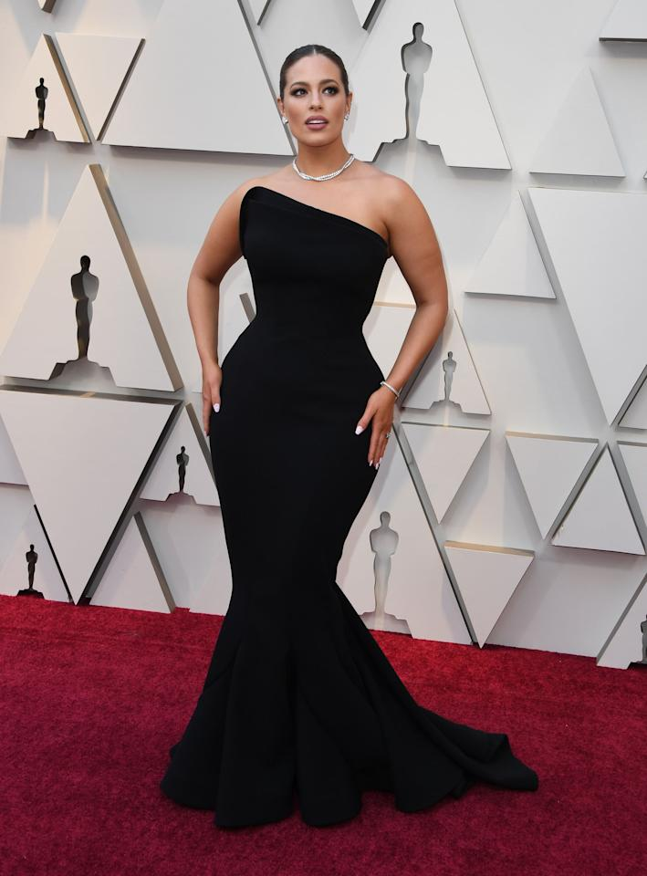 <p>Graham looked like a goddess on the Oscars red carpet, where the supermodel served as one of the official hosts for the red carpet show and wore a strapless corset mermaid gown custom-made by Zac Posen. It also must be noted that she was wearing $1 million worth of jewelry from Martin Katz, because she's worth it. </p>