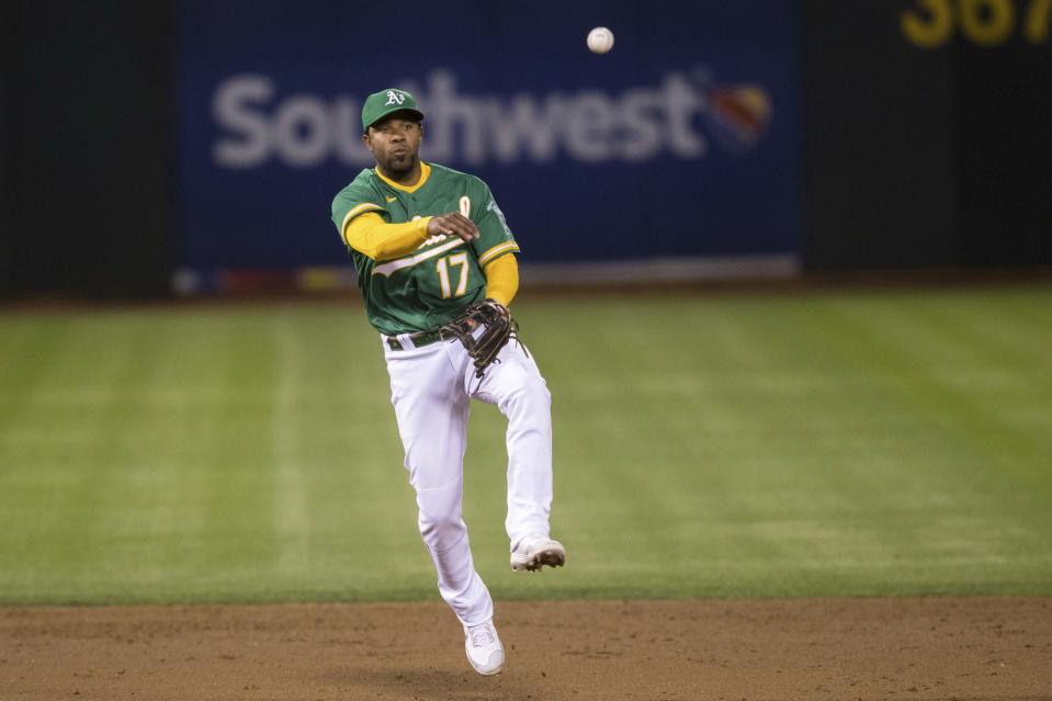 Oakland Athletics shortstop Elvis Andrus throws to first base for an out against the Los Angeles Angels during the sixth inning of a baseball game in Oakland, Calif., Monday, June 14, 2021. (AP Photo/John Hefti)