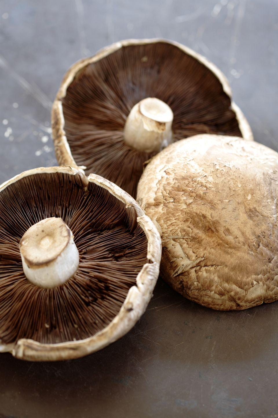 """<p>Skip the dough altogether and make personalized pizzas for each keto Super Bowl guest. You'll broil your mushroom caps to make a """"crust"""" and then load up on mozzarella, which is high in fat and protein but low on carbs.</p><p><a href=""""https://www.goodhousekeeping.com/food-recipes/a29773655/keto-portobello-mushroom-pizza-recipe/"""" rel=""""nofollow noopener"""" target=""""_blank"""" data-ylk=""""slk:Get the recipe for Keto Portobello Mushroom Pizza »"""" class=""""link rapid-noclick-resp""""><em><em><em><em>Get the recipe for Keto Portobello Mushroom Pizza <em><em>»</em></em></em></em></em></em></a></p>"""