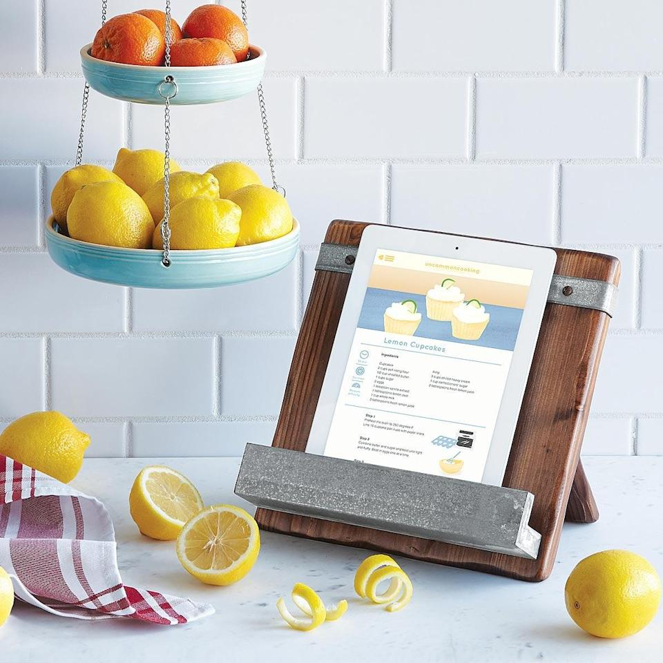 <p>This <span>Reclaimed Wood Cookbook Stand</span> ($120) will make cooking easier than ever. You can put an iPad or an actual book in it.</p>