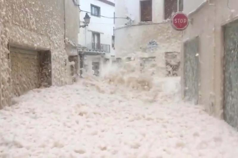 Strong winds blow thick sea foam through the streets of Tossa De Mar, Catalonia (SILVIA RAGOLTA SOMS via REUTERS)