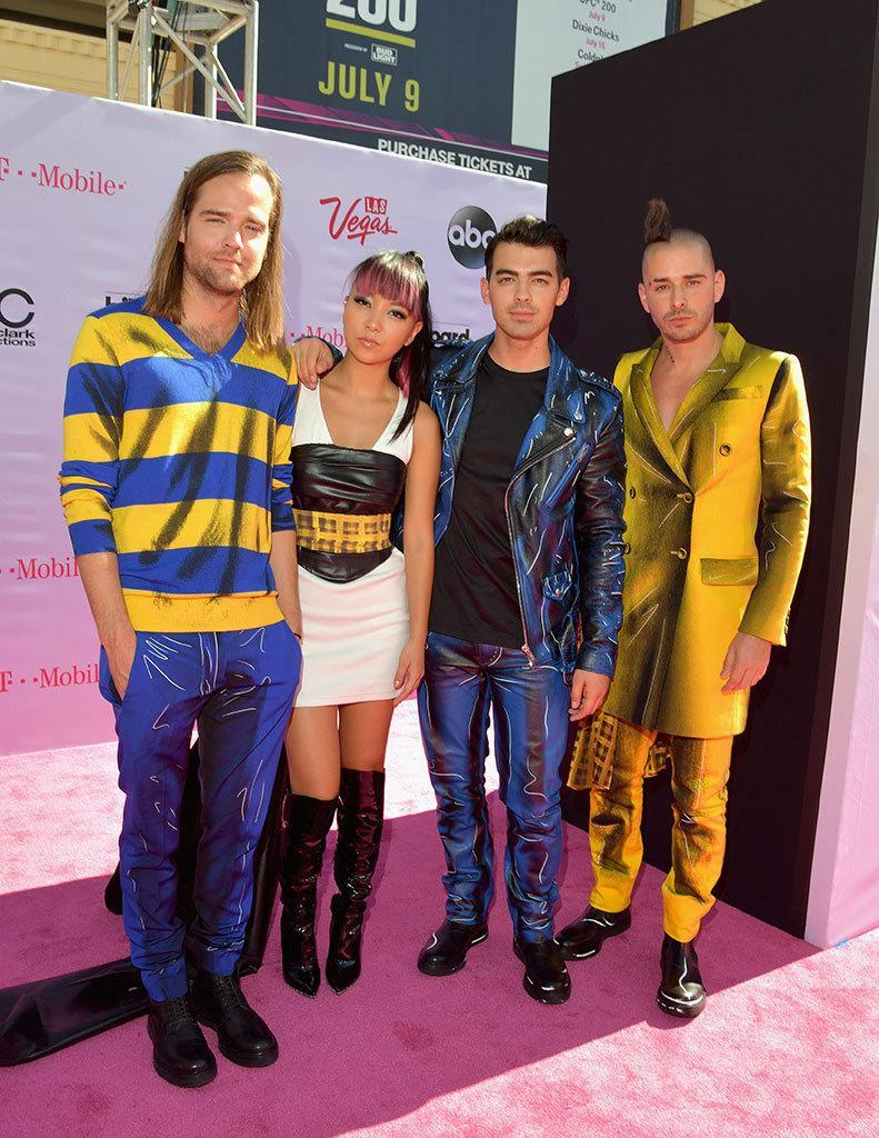 """<p>Joe Jonas's new band, DNCE, has gotten <a href=""""https://www.yahoo.com/beauty/joe-jonas-gets-kudos-for-new-video-costar-not-a-185527906.html"""" data-ylk=""""slk:major kudos;outcm:mb_qualified_link;_E:mb_qualified_link;ct:story;"""" class=""""link rapid-noclick-resp yahoo-link"""">major kudos</a> for its new video """"Toothbrush,"""" but tbh, we're still singing """"Cake by the Ocean."""" They opted for a coordinated look for the pink carpet. <i>(Photo: Lester Cohen/Getty Images)</i></p>"""