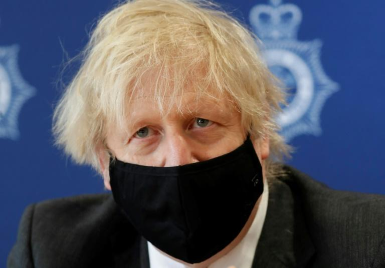 Boris Johnson said he hopes to emerge from a 'wretched year' in hard-hit Britain