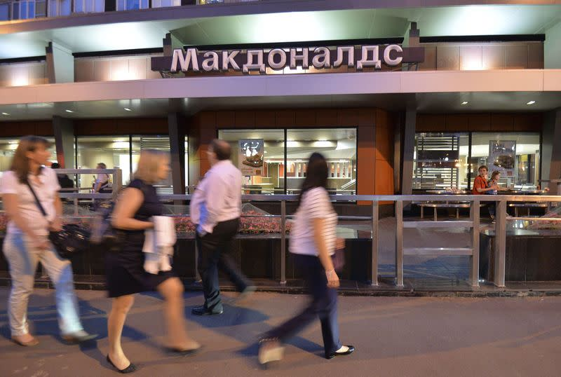 People walk past a closed McDonald's restaurant in Moscow