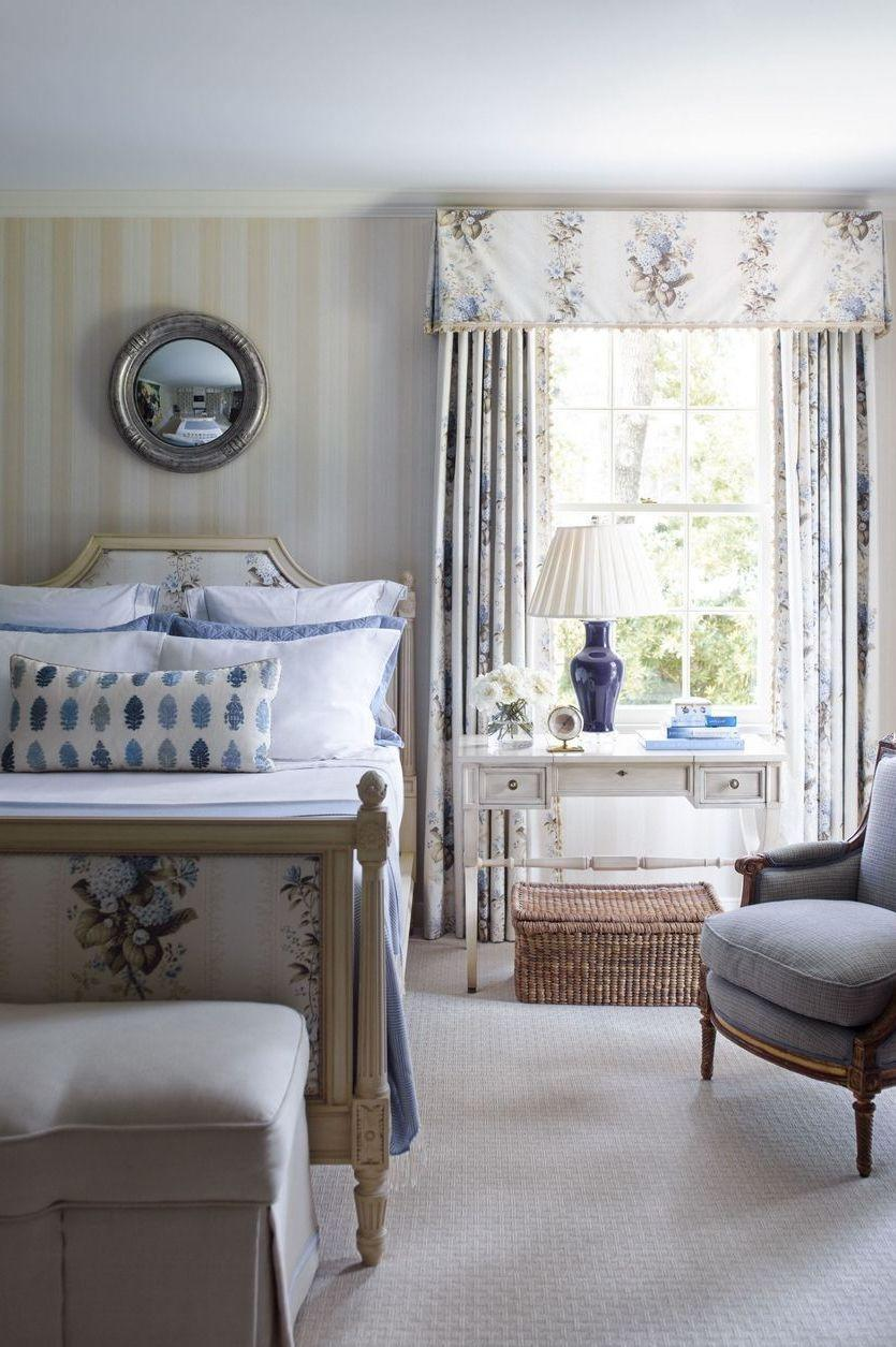 """<p>In the master bedroom of <a href=""""https://www.elledecor.com/design-decorate/house-interiors/a8632/most-beautiful-home-in-houston/"""" rel=""""nofollow noopener"""" target=""""_blank"""" data-ylk=""""slk:a Houston home"""" class=""""link rapid-noclick-resp"""">a Houston home</a>, the bed is upholstered in a Schumacher fabric that are also used for the curtains. The subtle peachy wallpaper is by Farrow & Ball and the carpet is by Stark.<br><em><br>Farrow & Ball Broad Stripe Wallpaper, $195</em><br><a class=""""link rapid-noclick-resp"""" href=""""https://go.redirectingat.com?id=74968X1596630&url=https%3A%2F%2Fwww.anthropologie.com%2Fshop%2Fbroad-stripe-wallpaper%3Fcolor%3D004%26type%3DSTANDARD%26size%3DOne%2BSize%26quantity%3D1&sref=https%3A%2F%2Fwww.redbookmag.com%2Fhome%2Fg35083191%2Fwallpaper-design-ideas%2F"""" rel=""""nofollow noopener"""" target=""""_blank"""" data-ylk=""""slk:Shop the Look"""">Shop the Look</a></p>"""