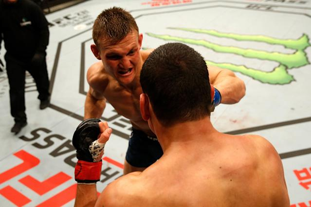 Ian Heinisch punches Cezar Ferreira of Brazil in their middleweight bout during the UFC Fight Night event inside Arena Parque Roca on Nov. 17, 2018 in Buenos Aires, Argentina. (Getty Images)