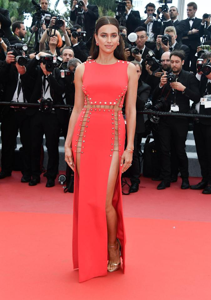 <p>In an Atelier Versace dress, Versace sandals, and Chopard jewelry.</p>