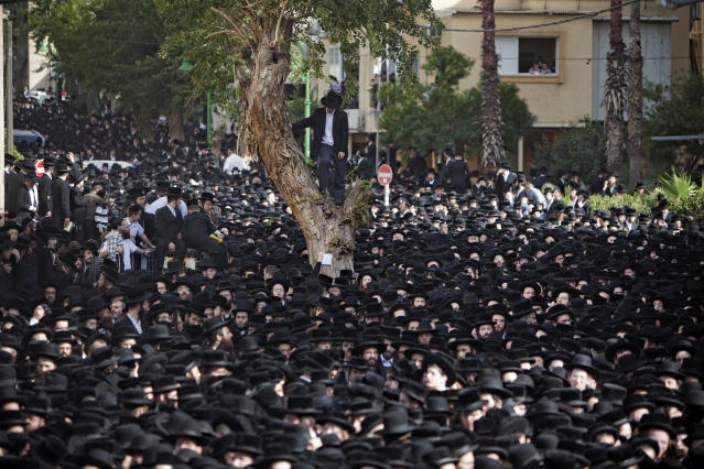 <p>Ultra-Orthodox Jews attend the funeral of Rabbi Moshe Yehoshua Hager, leader of the Hassidic sect Vizhnitz in Israel, in Bnei Brak, an Ultra-Orthodox Jewish town near Tel Aviv, Israel, March 14, 2012. (Photo: Oded Balilty/AP) </p>
