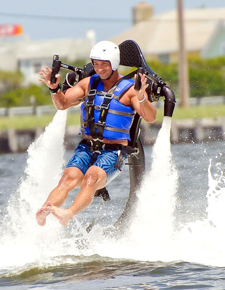 "Because getting paid to live in a beachfront resort for a national reality show isn't exciting enough, the cast of the ""Jersey Shore"" decided to allow themselves to be shot into the air over the Garden State's beautiful Barnegat Bay via jetpacks on Saturday. Mike ""The Situation"" Sorrentino looked like he was having fun, despite the fact he was forced to keep his famous abs covered with a life jacket. (6/23/2012)"