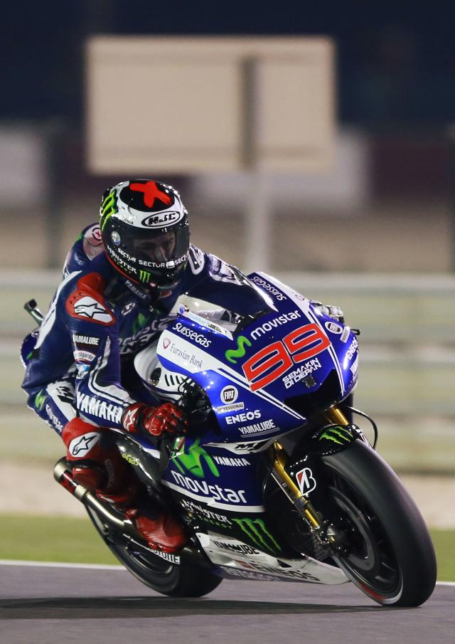 Yamaha MotoGP rider Jorge Lorenzo of Spain rides his bike during a free practice session at the MotoGP World Championship at the Losail International circuit in Doha March 20, 2014. REUTERS/Mohammed Dabbous (QATAR - Tags: SPORT MOTORSPORT)