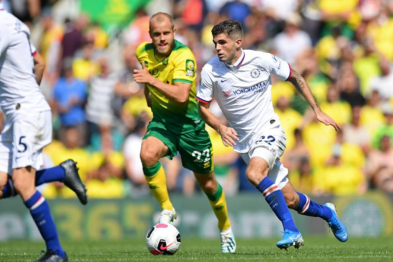 Chelsea's US midfielder Christian Pulisic (R) vies with Norwich City's Finnish striker Teemu Pukki (C) during the English Premier League football match between Norwich City and Chelsea at Carrow Road in Norwich, eastern England on August 24, 2019. (Photo by Daniel LEAL-OLIVAS / AFP) / RESTRICTED TO EDITORIAL USE. No use with unauthorized audio, video, data, fixture lists, club/league logos or 'live' services. Online in-match use limited to 120 images. An additional 40 images may be used in extra time. No video emulation. Social media in-match use limited to 120 images. An additional 40 images may be used in extra time. No use in betting publications, games or single club/league/player publications. / (Photo credit should read DANIEL LEAL-OLIVAS/AFP/Getty Images)