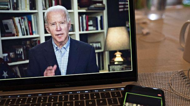 PHOTO: Former Vice President Joe Biden, 2020 Democratic presidential candidate, speaks during a virtual press briefing on a laptop computer in this arranged photograph in Arlington, Virginia, U.S., on Wednesday, March 25, 2020. (Andrew Harrer/Bloomberg via Getty Images)