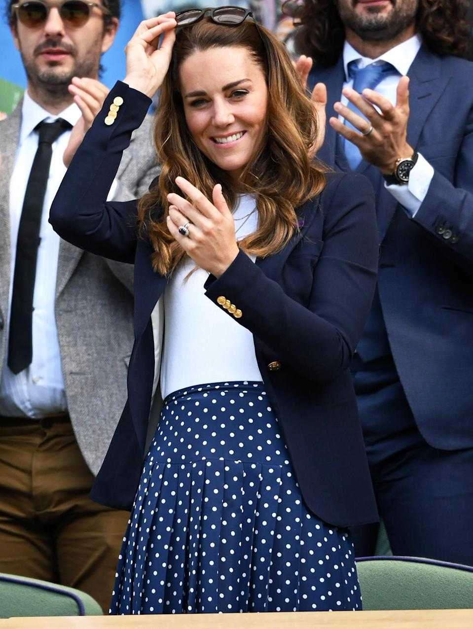 <p>Kate Middleton removes her sunglasses to get a good look at the Wimbledon players in London, England.</p>