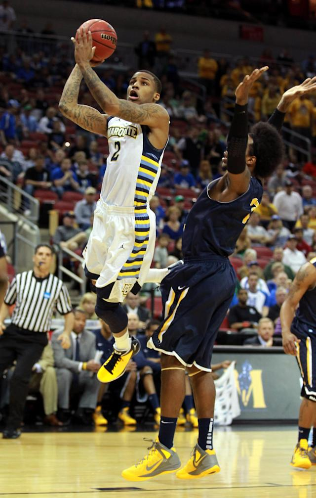 LOUISVILLE, KY - MARCH 17: Vander Blue #2 of the Marquette Golden Eagles goes up for a shot against Edward Daniel #2 of the Murray State Racers in the first half during the third round of the 2012 NCAA Men's Basketball Tournament at KFC YUM! Center on March 15, 2012 in Louisville, Kentucky. (Photo by Andy Lyons/Getty Images)