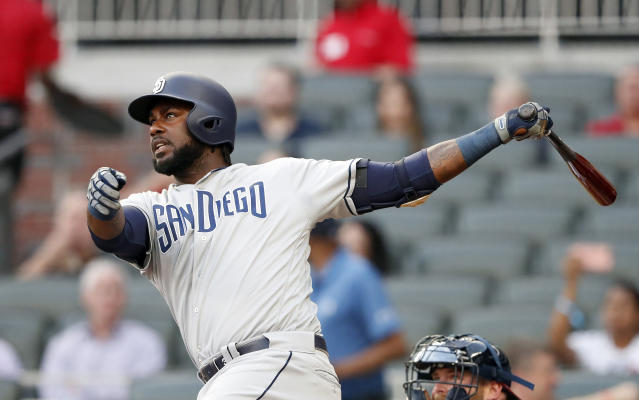 San Diego Padres' Franmil Reyes (32) follows through on a solo home run in the first inning of a baseball game against the Atlanta Braves Tuesday, April 30, 2019, in Atlanta. (AP Photo/John Bazemore)
