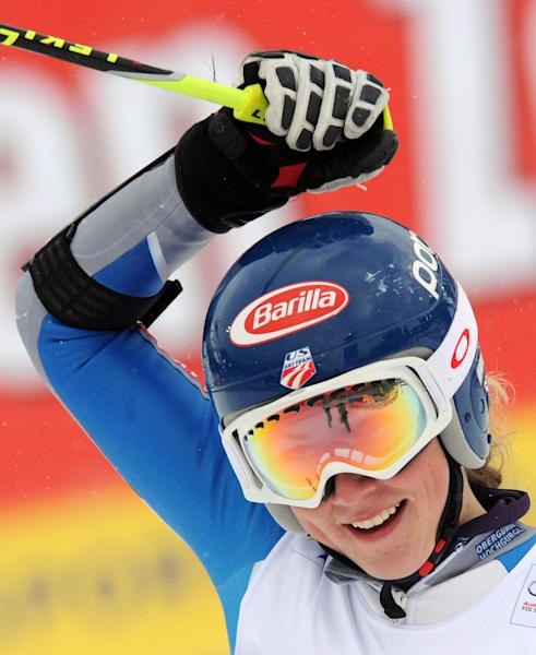 Eighth placed Mikaela Shiffrin, of the U.S., smiles at the finish line of an alpine ski, women's World Cup giant slalom in Semmering, Austria, Friday, Dec. 28, 2012. (AP Photo/Pier Marco Tacca)