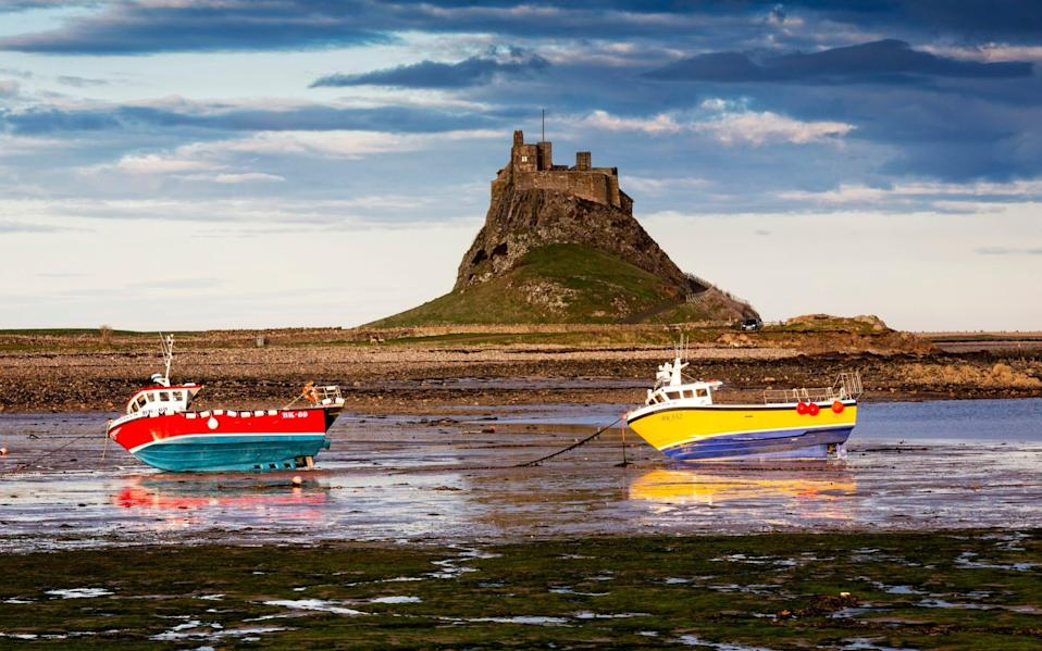 Lindisfarne Castle beyond the Holy Island's harbour - Chris Lishman/Getty