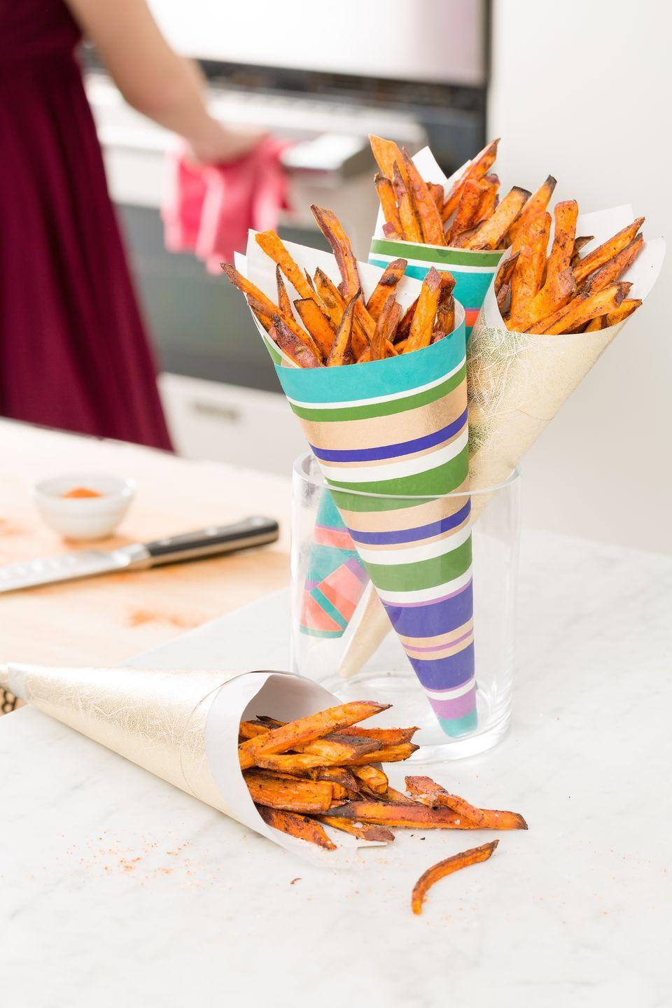 "<p>Spice up your sweet potato fries with chipotle seasoning and citrusy ranch crema.</p><p>Get the recipe from <a href=""/cooking/recipe-ideas/recipes/a44687/spiced-sweet-potato-fries-ranch-crema-recipe/"" data-ylk=""slk:Delish"" class=""link rapid-noclick-resp"">Delish</a>.</p>"