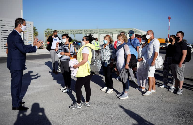 FILE PHOTO: Greek Tourism Minister Harry Theoharis welcomes passengers from Germany, who were frontline workers during the coronavirus disease (COVID-19) outbreak, after landing on a TUI Airways flight at Kos International Airport on the island of Kos