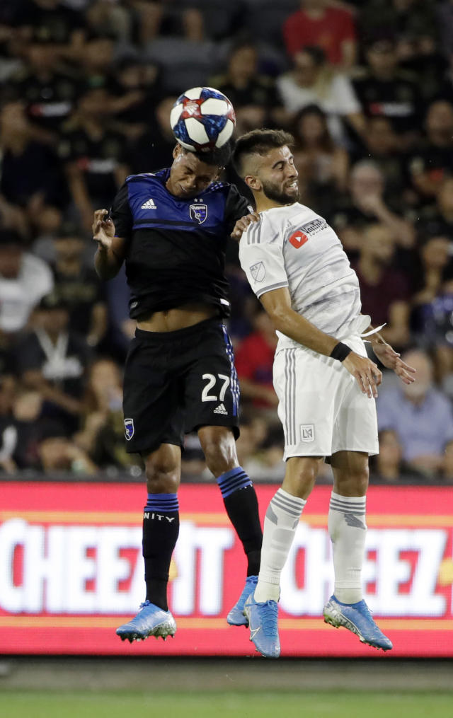 San Jose Earthquakes defender Marcos Lopez (27) works for a header next to Los Angeles FC forward Diego Rossi during the first half of an MLS soccer match Wednesday, Aug. 21, 2019, in Los Angeles. (AP Photo/Marcio Jose Sanchez)